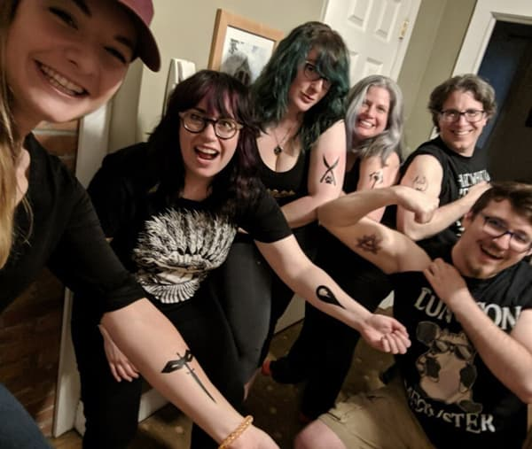 The Brunch Club showing off their class tats.